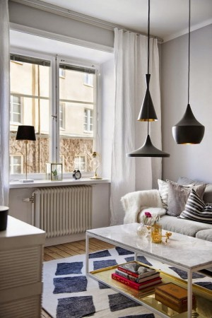 small-swedish-apartment-with-lamps-by-tom-dixon10
