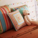 fabric-for-childrens-rooms-by-harlequin-cushions4.jpg
