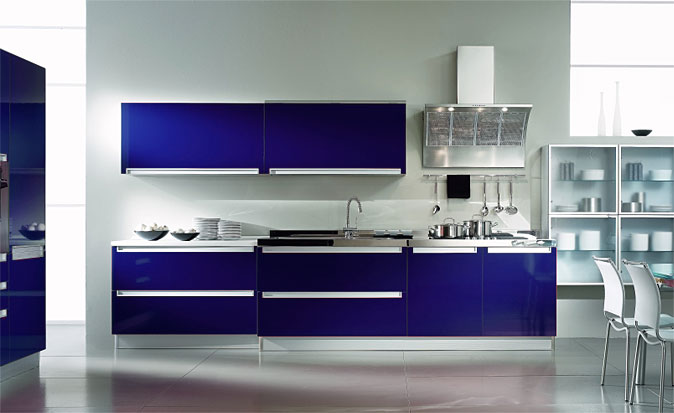Contemporary-kitchen-in-blue-and-white-with-glass-door-shelves-cabinets-and-sink-with-aspirator