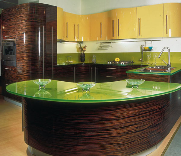 Contemporary-kitchen-with-green-glass-table-top-kitchen-countertop-and-yellow-drawers-and-cabinets