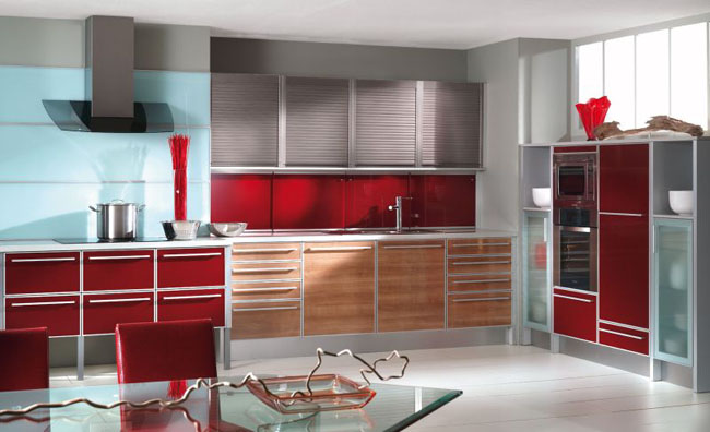 Modern-kitchen-in-red-with-glass-top-table-red-leather-chairs-and-wood-drawers-and-cabinets